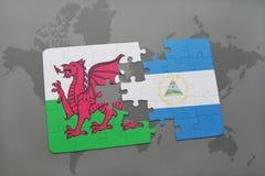 verwirren Sie mit der Staatsflagge von Wales und von Nicaragua auf einer Weltkarte Stockfoto