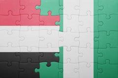 verwirren Sie mit der Staatsflagge von Yemen und von Nigeria lizenzfreie stockfotografie