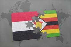 verwirren Sie mit der Staatsflagge von Yemen und von Simbabwe auf einer Weltkarte Stockbild
