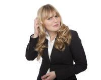 Verwirrte junge Geschäftsfrau Stockfotos
