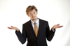 Verwirrter Geschäftsmann, der verwirrt schaut Stockbilder