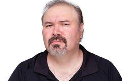 Verwirrter Mann von mittlerem Alter mit einem Spitzbart stockfotografie