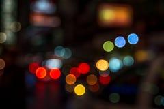 Verwischen Sie abstraktes bokeh des Straßenstadtnachtlichthintergrundes Lizenzfreie Stockfotos
