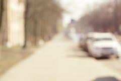 Verwischen Sie Hintergrund, Sommerzeit in der Stadtstraße mit Lizenzfreie Stockbilder