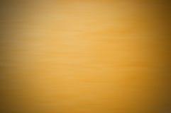 Verwischen Sie undurchsichtigen gelben Hintergrund mit einem flockigen Licht Stockfoto