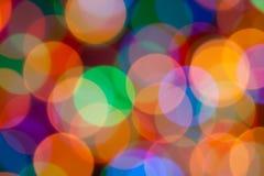 Verwischendes abstraktes Rundschreiben beleuchtet Bokeh-Farbhintergrund Stockfotos