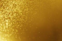 Verwischte helles abstraktes Weihnachten bokeh Gold des Funkelns Hintergrund Lizenzfreies Stockfoto