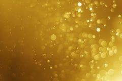 Verwischte helles abstraktes Weihnachten bokeh Gold des Funkelns Hintergrund Stockbilder