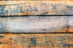 Verwitterte alte gestreifte Beschaffenheit des hölzernen Musters des natürlichen Hintergrundes der Bretter-ein Lizenzfreies Stockbild