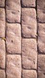 Verwitterte Stein gepflasterte Straße Beschaffenheit, Vignette Stockbilder