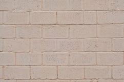 Verwitterte und befleckte farbige beige Blockwandbeschaffenheit Stockbilder