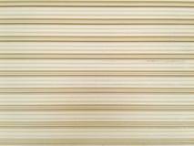 Verwitterter und rostiger Hintergrund der Stahltür für Design, Beschaffenheit von Stockbild