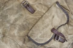 Verwittertes Militärarmee-kakifarbiges Tarnungs-Gewebe mit Tasche, Ba Stockbilder