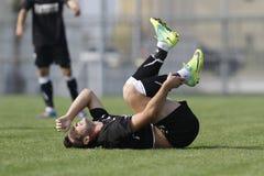Verwonde voetbalster royalty-vrije stock afbeeldingen