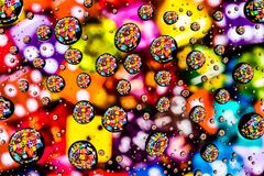 Macro Water Drops and Multicolored Dice Abstrace stock photo