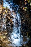 Ancient waterfall in the forest stock photos