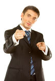 Very angry businessman pointing at the camera. Over white background Stock Photography