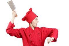 Very angry girl cook. Very angry girl the cook in a red form with a big knife on the isolated white background royalty free stock images