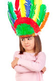Very angry girl with indian feathers. On a white background Royalty Free Stock Photography