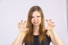 Very angry mother. Young plump woman with brown hair pose various emotions  in studio Royalty Free Stock Images
