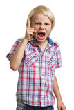 Very angry shouting boy with finger raised on white. Angry shouting boy with finger raised isolated on white background royalty free stock image