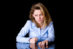 Very angry yougn female, hit desk with her fist Stock Images