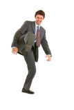 Very angry young businessman hard  kicking Stock Image