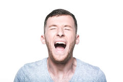 Very angry young man screaming Royalty Free Stock Photos