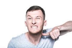 Very angry young man on whited Stock Photos