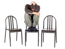 Very anxious man. Very anxious and sad man hiding himself and alone Stock Image