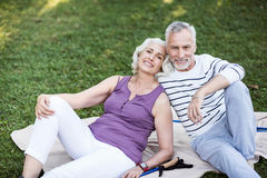 Very attractive elderly couple enjoying themselves in park Stock Photography
