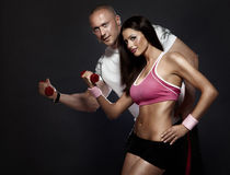Very attractive fit couple at the gym . Stock Photography