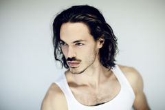 Very attractive young, athletic, muscular man smiling beauty portrait royalty free stock images