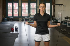 Attractive Young Brunette Woman Pauses While Jumping Rope at Gym Stock Image