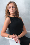 Very attractive young woman in a black dress with luxury accesso Royalty Free Stock Photo