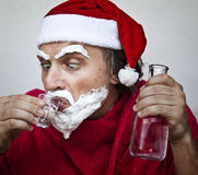 Very bad Santa Claus. Bad Santa Claus with a beard of shaving cream royalty free stock photography