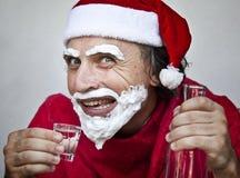 Very bad Santa Claus. Bad Santa Claus with a beard of shaving cream royalty free stock images