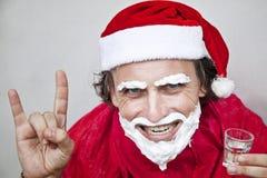 Very bad Santa Claus. Bad Santa Claus with a beard of shaving cream stock photo