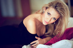 Very Beautiful And Girl Blonde In A Black Dress Lying On Th Royalty Free Stock Image