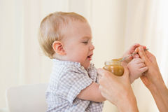 Very beautiful baby boy eating Stock Photography