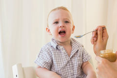 Very beautiful baby boy eating Royalty Free Stock Photography