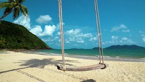 Very beautiful beach and swing stock video footage