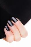 Very beautiful black nails close up. Stock Photography