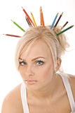 Very beautiful blonde with  of colored pencils Royalty Free Stock Photo