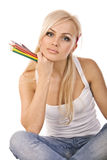 Very beautiful blonde with  of colored pencils Royalty Free Stock Photos