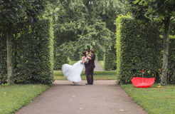 Very beautiful bride with groom hugging and dancing in green park, real wedding couple together forever happy smiling Stock Photography