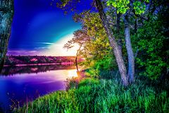 Very beautiful and colorful night and evening landscapes over the river Seversky Donets in the Rostov region. A rich moonlit sunse stock images