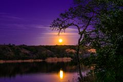 Very beautiful and colorful night and evening landscapes over the river Seversky Donets in the Rostov region. A rich moonlit sunse royalty free stock image