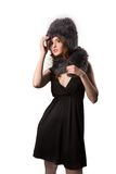 Very beautiful fashion woman wearing an elegant black dress with boot and winter fur hat Stock Photos