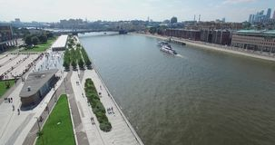 Very beautiful flying on a quadrocopter over the river in the city stock video